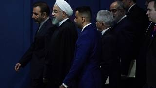 Iran's Hassan Rouhani walks with his entourage through the General Assembly Hall during the 74th session of the United Nations General Assembly at U.N. headquarters i
