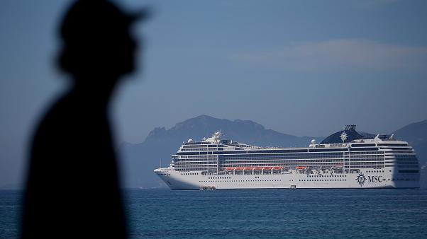 A cruise shipped docked in the bat at Cannes, France