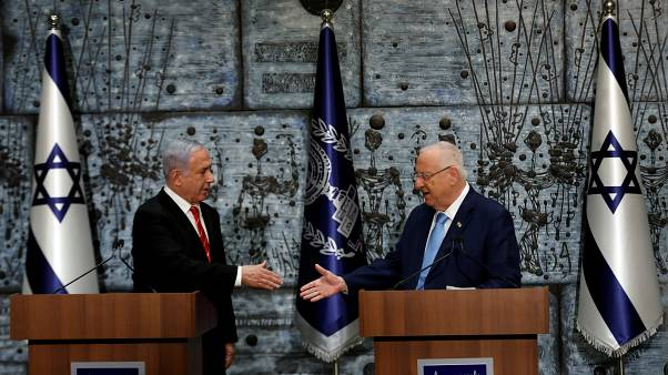 Israeli President Reuven Rivlin and Prime Minister Benjamin Netanyahu attend a nomination ceremony at the President's residency in Jerusalem September 25, 2019.