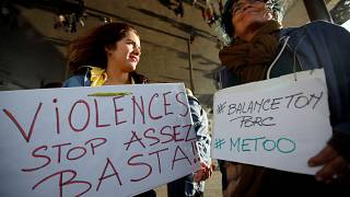 """FILE PHOTO: Women hold placards reading, """"Violence. Stop. Enough!"""" and #BalanceTonPorc - or 'expose your pig', during a gathering against gender-based  violence, France, 2017"""