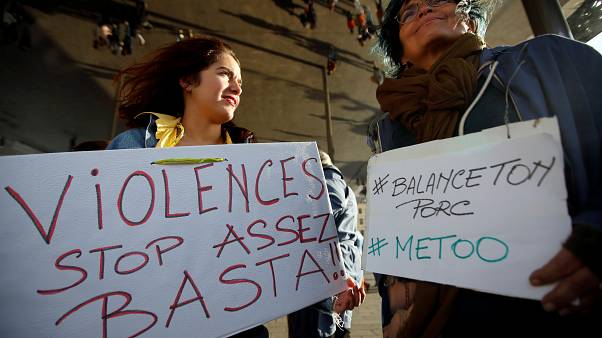 "FILE PHOTO: Women hold placards reading, ""Violence. Stop. Enough!"" and #BalanceTonPorc - or 'expose your pig', during a gathering against gender-based  violence, France, 2017"