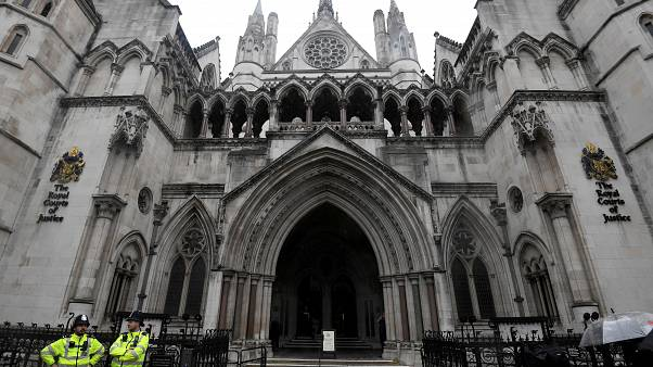 Police officers outside the Royal Courts of Justice in London, UK