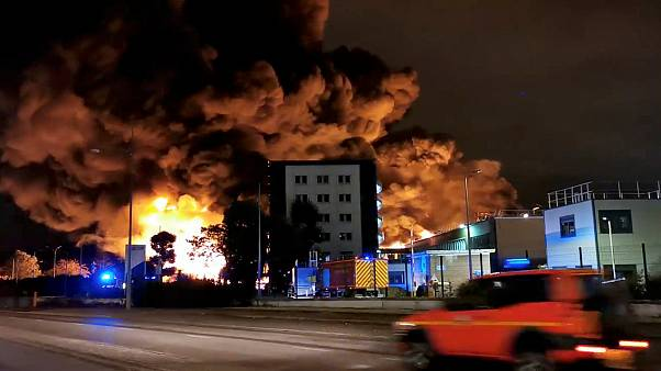 Smoke rises from a fire at a factory of Lubrizol in Rouen, France, September 26, 2019, in this still image from video obtained via social media