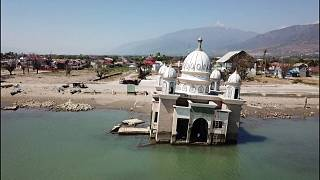 Drone images show damage one year after Indonesia earthquake, tsunami