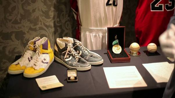 Watch: Babe Ruth's uniform and Magic Johnson's boots up for auction
