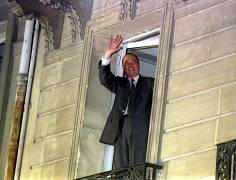Newly elected French president Jacques Chirac waves from the balcony of his campaign headquarters after he defeats socialist party candidate Lionel Jospin with 52 percent of t