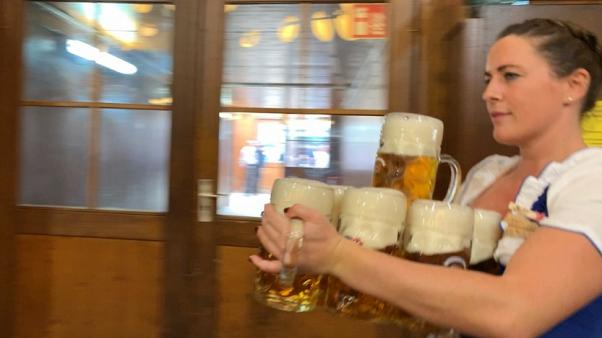 Giant beers, tips and 15-hour shifts: A day in the life of an Oktoberfest waitress