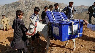 Afghan presidential election ballot boxes are taken to mountainous regions