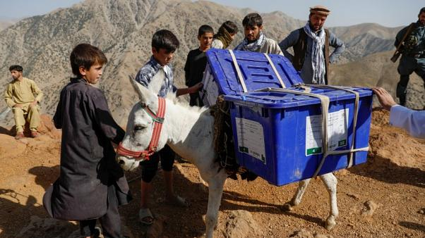 Afghan presidential election ballot boxes are taken to mountainous regions