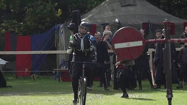 Knights participate in jousting contest on bikes in Berlin