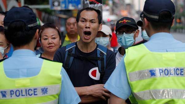 Hong Kong police shoot young protester at close range