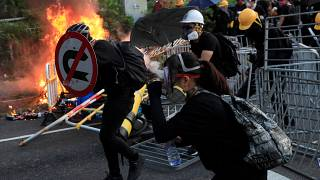 Hong Kong police break up protests in day of violence