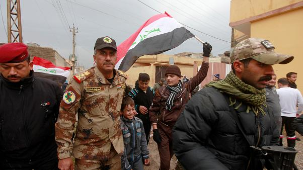 December 14, 2016 - Lieutenant General Abdelwahab al-Saadi (C) walks with children as they celebrate in Qadisiyah neighborhood north of Mosul, Iraq, December 14, 2016