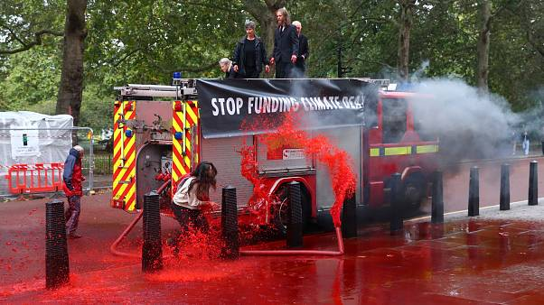Extinction Rebellion: Climate activists fire hundreds of gallons of fake blood at the UK's Treasury
