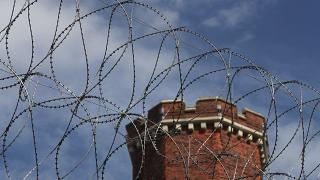 A general view shows razor wire surrounding the former Reading prison where Oscar Wilde was gaoled for gross indecency with another man, in Reading, Britain September 1, 2016.