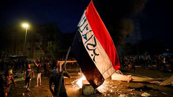 Demonstrators gather at a protest during a curfew, two days after the nationwide anti-government protests turned violent, in Baghdad, Iraq October 3, 2019.