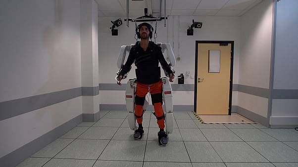 A patient with tetraplegia walks using an exoskeleton in Grenoble, France, in February 2019, in this still image taken from a video handout.