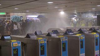Hong Kong: Protesters target station amid anger at face-mask law