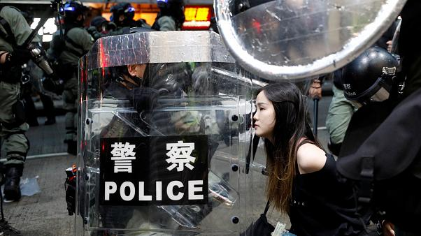 Arrests after police charge protesters in Hong Kong