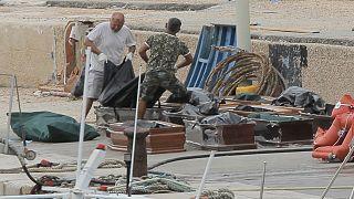 جثث لمهاجرين انقلب زورقهم قبالة سواحل جزيرة لامبيدوزا الإيطالية