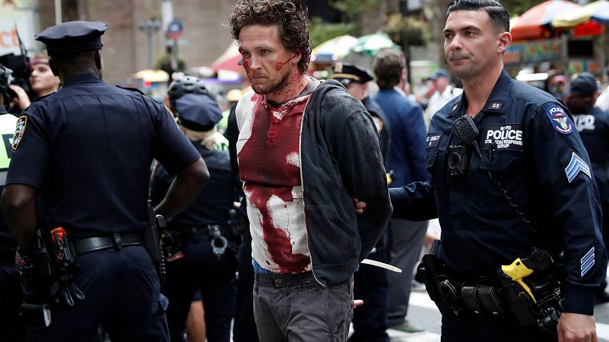 'Bloodied protesters' stage climate demonstration in New York City
