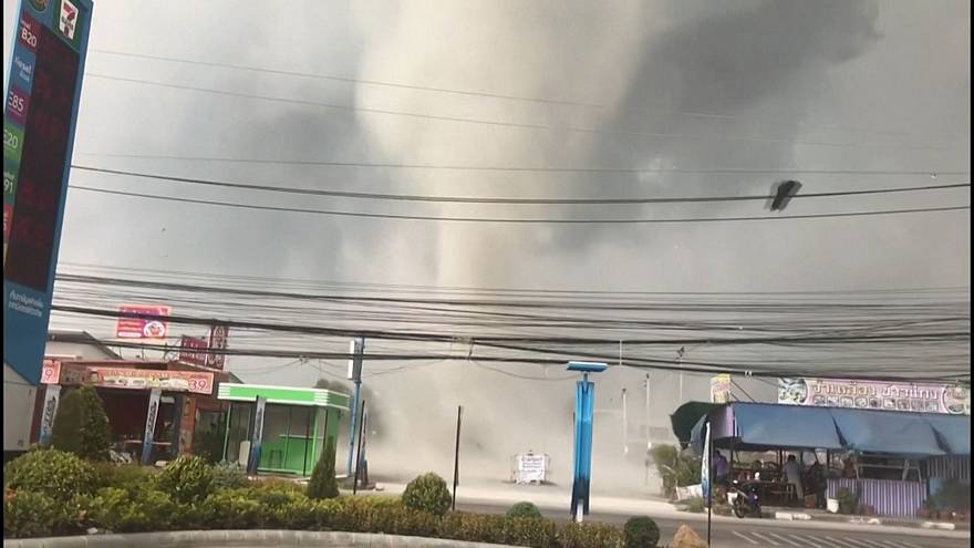 Blustering gustnado in Thailand picks up roofs and signs