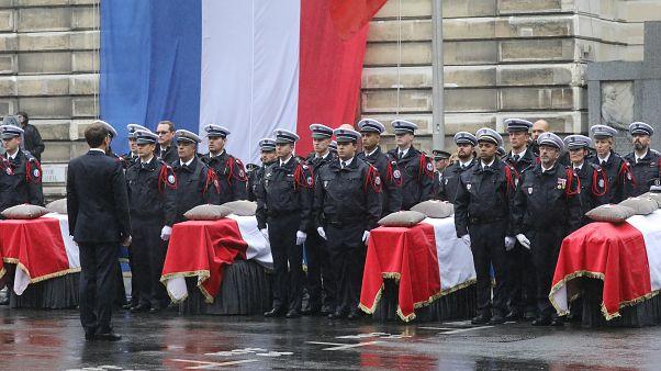 الرئيس الفرنسي إيمانويل ماكرون خلال مراسم تأبين أربعة ضباط شرطة فرنسيين قتلوا في باريس. أكتوبر 2019