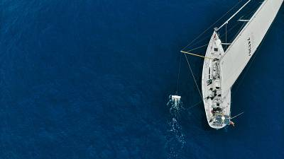 Here the trawler that catches ocean plastic for research can be seen next to the ship