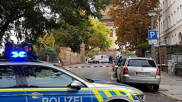 Police secure the area after a shooting in the eastern German city of Halle