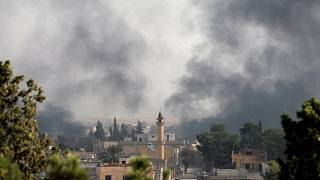Smoke rises over the Syrian town of Ras al-Ain, as seen from the Turkish border town of Ceylanpinar, Sanliurfa province