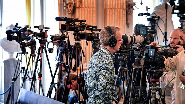 Journalists prepare themselves for the announcement of the winners of the Nobel Prize in Literature 2019, in Stockholm
