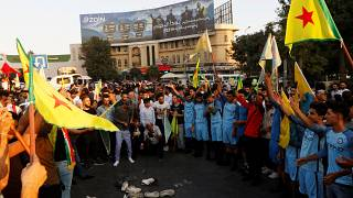 Kurds protest the Turkish offensive against Syria during a demonstration in Iraq