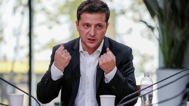 Ukraine's President Volodymyr Zelenskiy holds a press-marathon at a food market in Kiev, Ukraine October 10, 2019.