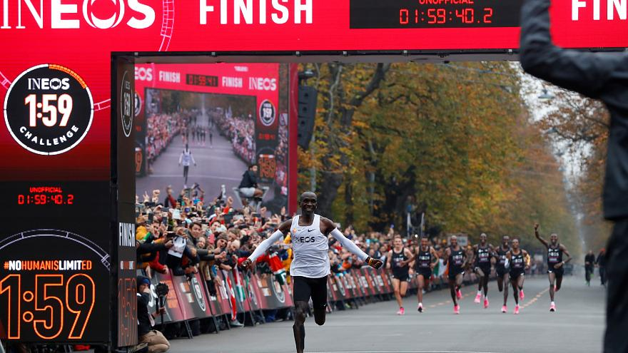 enya's Eliud Kipchoge, the marathon world record holder, crosses the finish line during his attempt to run a marathon in under two hours in Vienna, Austria, October 12, 2019.