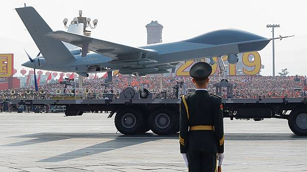 Military vehicle carrying a drone travels past Tiananmen Square during the military parade marking the 70th founding anniversary of People's Republic of China
