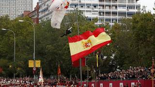 Parachutist left dangling during Spain's National Day parade
