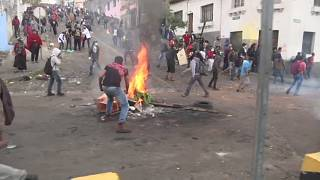 Rocks and tear gas as protesters clash with riot police in Ecuador