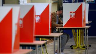 A man attends a voting during parliamentary election at a polling station in Warsaw, Poland, October 13, 2019.