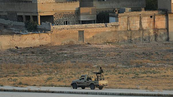 Turkish-backed Syrian rebels are seen in the Syrian border town of Tel Abyad, as seen from Akcakale, Turkey, October 13, 2019.