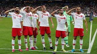 Turkish footballers repeat military salutes in France match despite UEFA probe