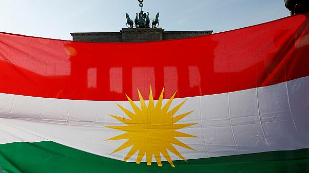 Protesters hold a Kurdish flag during a rally against the Turkish military operation in Syria, in Berlin, Germany, October 14, 2019