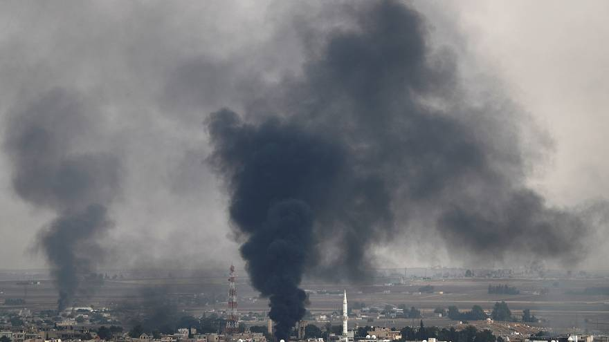 Smoke rises over the Syrian town of Ras al Ain, as seen from the Turkish border town of Ceylanpinar