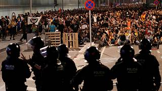 How do the protests in Barcelona compare with those in Hong Kong?