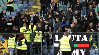 Stewards and Bulgaria fans during the Bulgaria-England Euro 2020 qualifier in Sofia on October 14, 2019