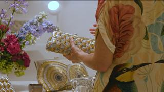 How are underprivileged women in Lebanon being empowered through luxury bags?