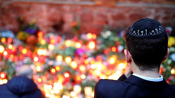 Mourners gather at the scene of the Halle synagogue attack