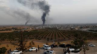 Smoke rises over the Syrian town of Ras al Ain, as seen from the Turkish border town of Ceylanpinar, in Sanliurfa province, Turkey, October 16, 2019.