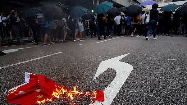 A Chinese flag burns as anti-government protesters block a street in Central Hong Kong, China October 4, 2019