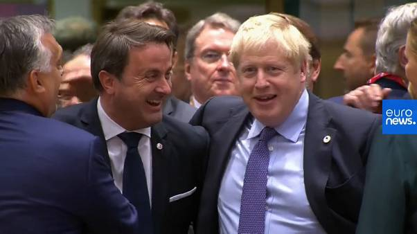 Watch: Hearty handshakes as Boris Johnson toasts Brexit deal with EU leaders