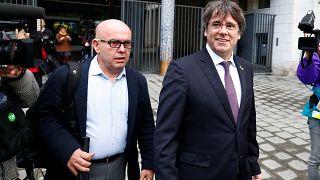 Former Catalan leader Carles Puigdemont walks free after handing himself to Brussels police